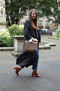 Chloe Macdonnell Fashion and Features Writer at LFW SS17  Topshop coat and boots Zara top Levis jeans Louis Vuitton bag.