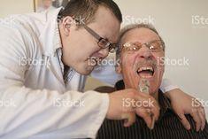 Dents dentiste tirant Senior photo libre de droits
