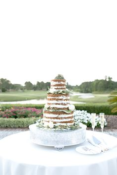 A Naked Carrot Cake, looks too delicious to cut into!  A great example of how to blend rustic with class for an outdoor Wedding. [Kelli Boyd Photography] [Berkeley Hall Club Weddings]