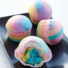 The radical rainbow effect is hip once again. Create the tie dye effect inside and out, with cupcakes featuring layered batter colors and three shades of candy clay on top.