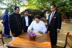 Marco Pierre White signing the guest book at Nuga Gama. In the background is village Headman Liyanage, Manager Food and Beverages Travis Casather and Promotions Manager Shehara Fernando - Cinnamon Grand