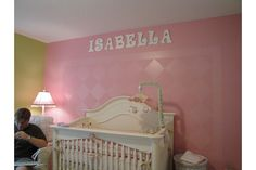 Harlequin Design on Wall and Letters  Letters were from Hobby Lobby. Mobile Custom bought from Precious Cargo- Smyrna, GA. Crib is Munire Bristol. Lamp from Target. Bedding from Polka Tot Designs in Mobile, AL.
