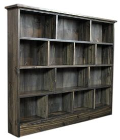 "DVD storage: Measuring 40"" tall x 48"" wide and 12"" deep, this solid pine DVD shelving unit can hold close to 300 DVDs. It's finished with ebony stain and easy-to-clean satin polyurethane/varnish. $265 Diy Dvd Storage, Dvd Storage Shelves, Movie Storage, Bed Storage, Wood Shelves, Storage Ideas, Shelving Ideas, Movie Shelf, Basement Remodeling"