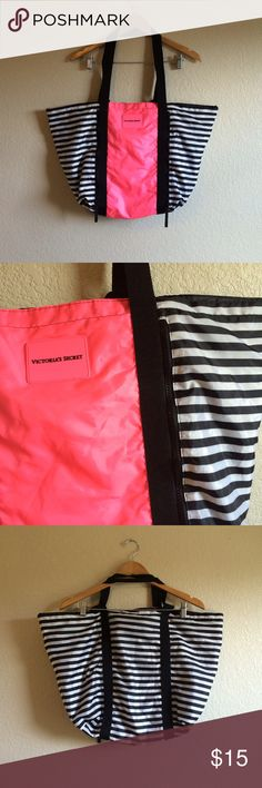 Victoria's Secret • Bag This cute black and white striped tote bag has a pink pocket that is zippered on both sides. Can be worn as a shoulder tote or carried by the shorter handles. No zipper or inside pockets. Very spacious. Victoria's Secret Bags Totes