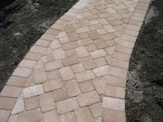"Detail of the walkway with 6""x9"" solder course border with 6""x9"" and 6""x6"" pavers set in a diagonal ""T"" pattern."