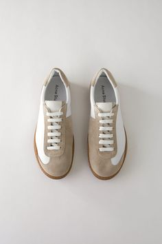 Acne Studios Lars Leather white are soft, minimal sneakers inspired by vintage indoor sport shoes with Acne Studios branded tongues and monograms. Ankle Shoes, Men's Shoes, Baby Shoes, Everyday Shoes, Plimsolls, White Sneakers, Women's Sneakers, Sneakers Sale, Fashion Shoes