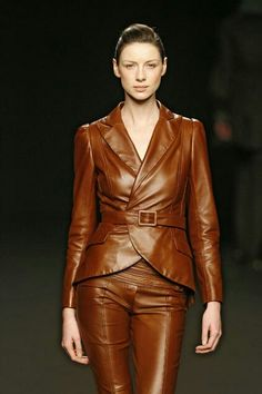 Brown leather belted jacket and pants ensemble runway fashion