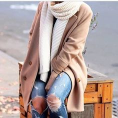 Ripped skinny jeans, camel colored trench coat and a cream colored scarf