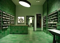 Design studio Weiss—heiten used emerald-coloured tiles to cover the walls, floors and surfaces of the new Berlin store for skincare brand Aesop.