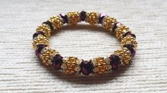 Metallic purple and gold sparkly bracelet by Hellenna on Etsy, £15.00