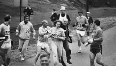 19 Apr 1967, Hopkinton, Massachusetts, USA — Trainer Jock Semple — in street clothes — enters the field of runners (left) to try to pull Kathy Switzer (261) out of the race. Male runners move in to form a protective curtain around female track hopeful until the protesting trainer is finally wedged out of the race
