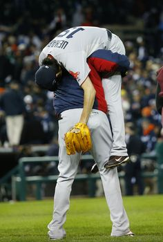 Boston Red Sox's David Ortiz picks up Koji Uehara after the Red Sox defeating the Detroit Tigers 4-3 in Game 5 of the ALCS.