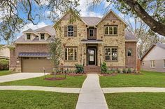 5006 WIGTON. Gorgeous 4 bdrm/3.5 bath traditional home w/striking brick & stone elevation sits on spacious lot w/mature trees & lush landscaping in desirable Meyerland. New construction built by Meritage Homes! Wonderful floor plan w/master secondary bdrm down! Bernstein Realty, Houston Real Estate.