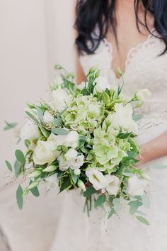 white and pale green lisianthus and hydrangea wedding bouquet | photo: mademoisellefiona.com