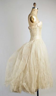 Evening underdress Design House: House of Dior (French, founded 1947) Designer: Christian Dior (French, Granville 1905–1957 Montecatini) Date: fall/winter 1955–1956 Culture: French Medium: synthetic Dimensions: Length at CB: 46 1/2 in. (118.1 cm)