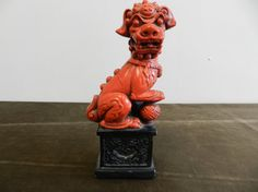 Vintage red & black Foo Dog statue on Etsy, $20.00