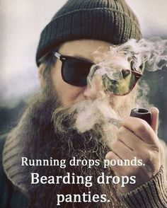 It looks like he's smoking the pipe, BUT IN FACT it is his beard who partakes in the tokes.