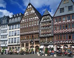 Street scene with pavement cafes, bars and timbered houses in the Romer area of Frankfurt, Germany, Europe