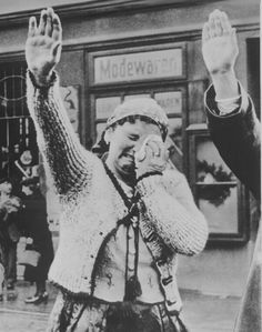 The tragedy of this Sudeten woman, unable to conceal her misery as she dutifully salutes the triumphant Hitler, is the tragedy of the silent millions who have been `won over' to Hitlerism by the `everlasting use' of ruthless force.