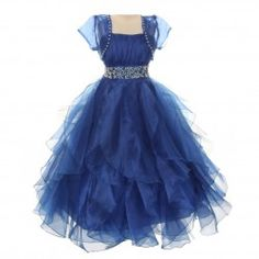 A gorgeous royal blue special occasion dress for your girl by Chic Baby. This organza dress has a cute bolero attached and a waistband embellished with tiny pearls. The cascading ruffles transforms it into a trendy dress creating a cute visual effect. It