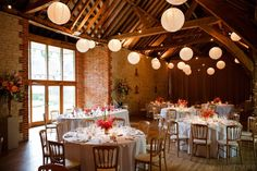 Wedding reception and table styling. White Chineese lanterns, gold chairs, pink flowers. Gold and pink wedding colour scheme. Bury Court Barn Wedding - Laura and Andy - Tony Hart Photo - Wedding Photographer Hampshire | Tony Hart Photo Blog
