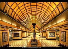 Gants Hill Underground station, London. The lines run on either side of this hall, which is notable for its Art Deco look and symmetry. I