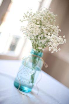 country wedding flowers, baby breath in blue mason jars
