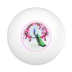 http://www.zazzle.com.au/peacock_cherry_blossoms_and_lattice-256389394444795576?rf=238523064604734277 Peacock Cherry Blossoms And Lattice Ping Pong Ball - This ping pong ball features a peacock perching on a cherry blossom branch in front of a lattice wall. It is light enough that you can add your own text.