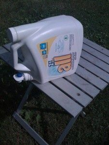 Reuse laundry detergent dispenser bottle to hold water for washing hands while camping.