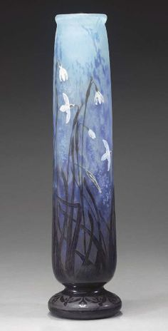 A WHEEL-CARVED, OVERLAID, AND ETCHED GLASS VASE   DAUM, CIRCA 1905   17½in. (44.5cm.) high   etched and gilt mark DAUM NANCY with the Cross of Lorraine