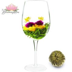 Certainly, it is a refreshing combo of hand-tied Maofeng with Globe Amaranth, two Jasmine Flowers as well as Marigold in the center. What a wonderful collection of Globe Amaranth, Marigold, Teas, White Wine, Jasmine, Wine Glass, Alcoholic Drinks, Bloom, Flowers