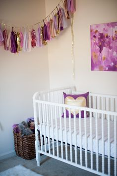 This is a great room idea for a purple and gold baby room. Pair this with Caden Lane's purple and gold dot baby bedding to finish off your nursery.