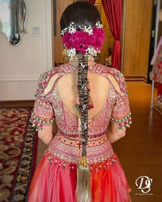 This unique hairstyle with a tassel zaari paranda and pink and white flowers is perfect for that extra glam! Pc: deepaksheshodiya #hairstyles #hair #hairgoals #hairideas #wittyvows #bridalhair #bridalhairstyle #bridalhairaccessories #wedding #indianwedding #indianbride #braids #braidstyles #ponytail Open Hairstyles, Indian Bridal Hairstyles, Unique Hairstyles, Braided Hairstyles, Bridal Braids, Pink And White Flowers, Braids For Short Hair, Floral Hair, Bridal Hair Accessories