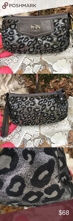 Coach clutch/wristlet Preowned in good Condition. (Has ink marks inside on the lining and a couple small one on the front. See last pic. Coach Bags Clutches & Wristlets
