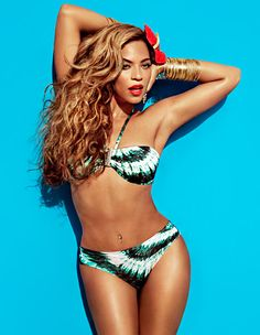 Beyonce! Great bikini look, flower in the hair and tons of arm candy. I think I'll try it this summer.