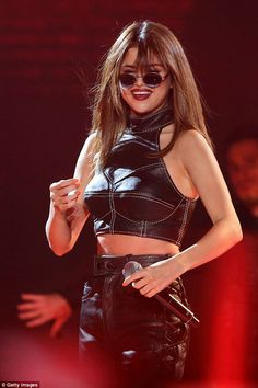 Crop it like it's hot in a leather top like Selena's. Click 'Visit' to buy now. #DailyMail