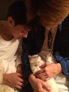 Tao, Sehun, and a cat. They look like loving parents! Taohun