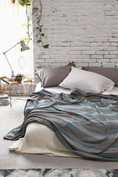Cool tones with a relaxing bed on the floor