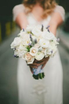 The bridesmaids will carry bouquets of blush spray roses, fresh lavender, jasmine vine, seeded eucalyptus, and dusty miller wrapped in slate grey ribbon.