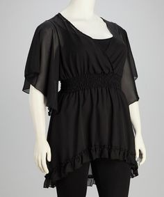 Something chic for the social butterfly. This flirty sheer tunic sweeps onto the scene with fluttering angel sleeves, ruffled trim and a figure-flattering design that accentuates the waist. Size note: This item runs small. Please refer to the size chart.
