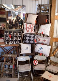 We need to find you a cute ladder to do this with your pillows. . NA-DA FARM OCTOBER BARN SALE