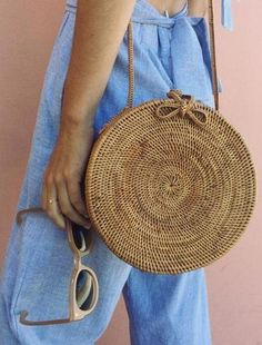 how to style a round bag : blue jumpsuit and sunglasses
