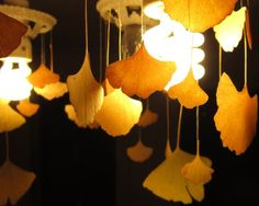 Detail of ginkgo chandelier ~ Leaves will move with any slight movement in the room. These may be pressed leaves. From: http://kclara.wordpress.com/#