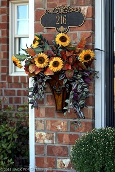 they are so lovely. A similar wall planter can be found at Garden Ridge (without flowers) fairly inexpensive. Autumn Decorating, Porch Decorating, Fall Wreaths, Door Wreaths, Country Wreaths, Floral Wreaths, Sunflower Wreaths, Front Door Decor, Front Porch
