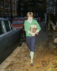 November 22, 1980 Lady Diana is pictured by the press photographers walking through a fashionable Kensington neighborhood