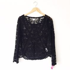 Xhiliration Black Lace Long Sleeve Top Brand new with tags. Size small. Juniors. Fits like an XS in my opinion. Gorgeous piece for summer! Sheer. First picture filtered. Retailed for $24.99. No trades or use of other sites. •0507160299• Xhilaration Tops Blouses