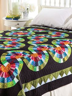 """Master the art of wedges with this beautiful winding project.   This would make the perfect project to work on throughout your busy summer. Lay it out in just about any way you please and you'll have something unique every time! This e-pattern was originally published in the Summer 2014 issue of  Quilter's World  magazine. Finished size is 85"""" x 85""""."""