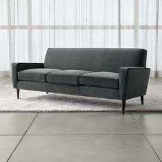 Whether referencing retro or playing it modern, eye-catching Torino adds flair to the casual family room.   Rooted in the straightforward confidence of mid-century design, the three-seat sofa's tailored lines showcase the indulgent softness of its durable cotton-blend velvet upholstery.