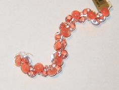 These are beautiful handmade Lampwork Beads from Unicorn Beads, These boro glass beads are in the color of coral reef. They measure approximately 10mm ( Length: 1.3 cm, width: 1.1 cm with a 2 mm hole) (these newer beads are more on the size of 9x7.5mm). This listing is for 10, 20 or 25 beads. Thank You for supporting my little ETSY Shop. I do appreciate it.