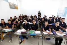How classrooms look around the world — in 15 amazing photographs - The Washington Post - 'Teacher Manel el Ayachi poses for a picture on the first day of a new school year at Linine Street Preparatory School in Tunis, Tunisia, September (Reuters) Schools Around The World, People Around The World, Around The Worlds, Beginning Of School, New School Year, World Literacy Day, World Teachers, Question Of The Day, Vintage School